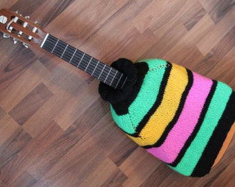 Original knitting covers for acoustic guitar. Knitted clothes for Guitar. Exclusive knitted covers on order.