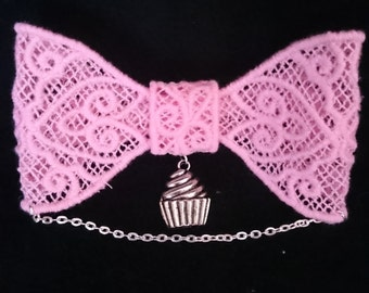 Pink lace hair bow with cupcake charm and silver chain