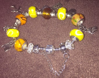 Yellow orange and silver charm bracelet 8""