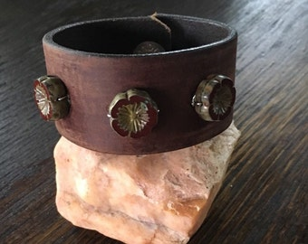 Brown leather cuff with red glass flower beads