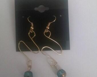 Gold serpentine earrings