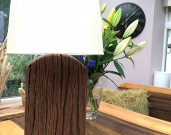 Unique solid wood lamp base, shade not included, due to personal choice.