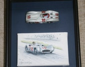 Framed model of Mercedes W196 with painting of Fangio