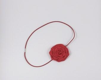 Single red rosette headband