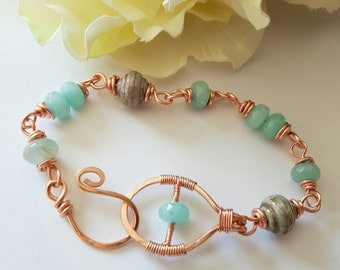 Aquamarine and glass beads, copper wired bracelet
