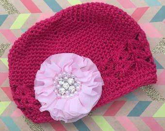 Pink knitted newborn hat
