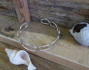 Handmade sterling silver loops cuff.