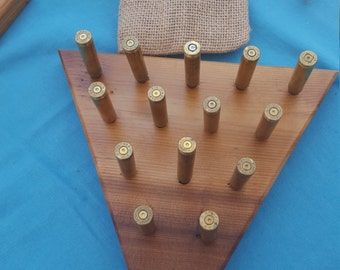 Handmade wood and bullet peg game