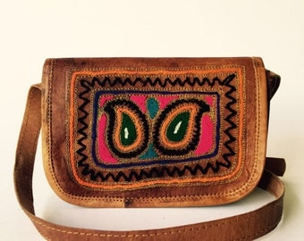 Embroidered leather sling bag