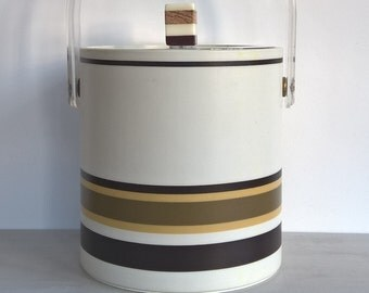 White vintage ice bucket with wood tones