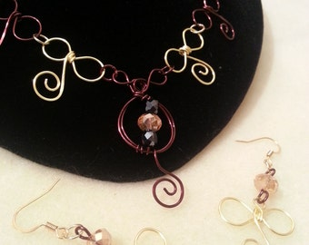 J bow necklace and earing