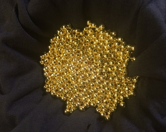 Gold toned 2mm beads. 1000 beads