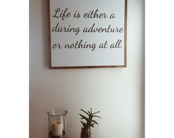 Life is either a daring adventure or nothing at all - quote sign