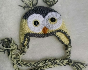 Yellow and gray, child's owl hat.
