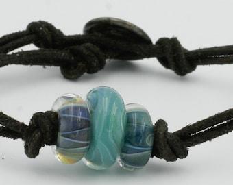 The Lucky Charm - Art Glass (lampwork) Bead Bracelet - Auqa Tone - Suede - Vintage Button