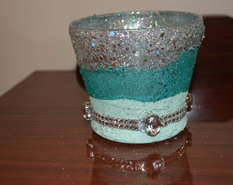 silver and teal candle holder