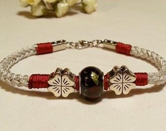 Hand-knitted cord bracelet