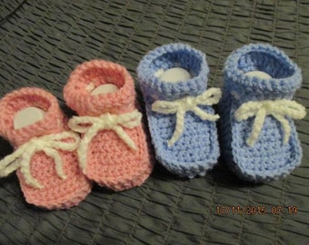 Baby shoes pink or light blue