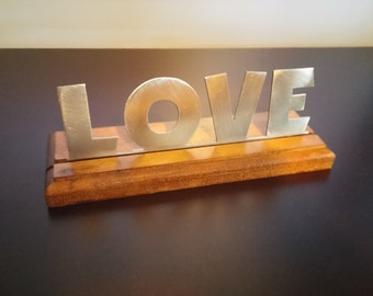 """Steel """"Love"""" with finished wood base"""