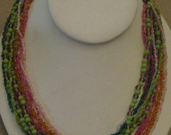 Un Worn Vintage Multi Strand Glass Seed Bead Necklace Multi Colored 10 Strands Main Colors Pink And Green