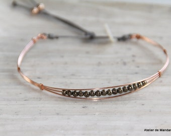 Collection Bangle Bracelet the mini plated rose gold and pyrites. Model filed