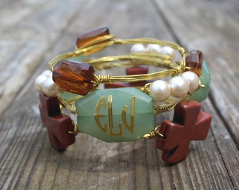 Green & Brown stacked bangles Cross