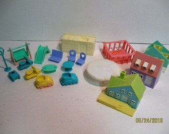 Assorted group of very small plastic doll houses and accessories