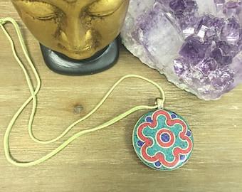 Reversable multi-colored stone pendant