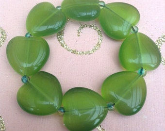 Green heart shaped glass beaded handmade elasticated bracelet.