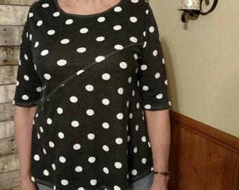 Polka dot top size large. T Shirt.  Black with white polka dots.