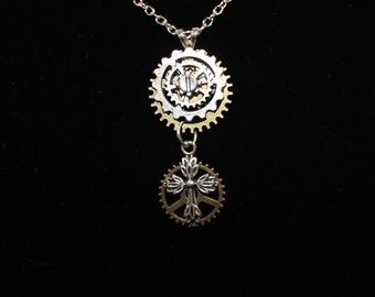 Necklace with stacked gears and cross