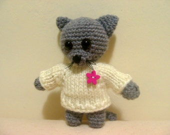 Knitted amigurumi cat toy