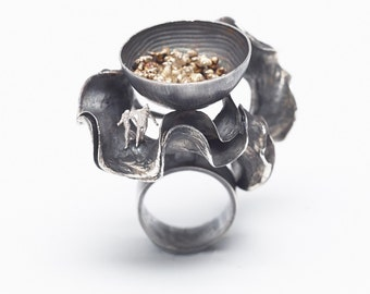 Silver ring with oxidized silver and gold details