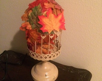 Fall themed bird cages, steam punk charms on top