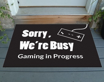 """Sorry, We're Busy. Gaming in Progress - Humorous Decorative Doormat  36"""" x 24"""" - Choose your color!"""