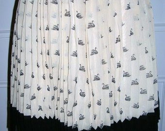 Pre-loved classic cream and black swan print accordion chiffon Alice in the Eve mini skirt size: 10