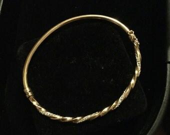 18 k gold bracket with swarvski crystals