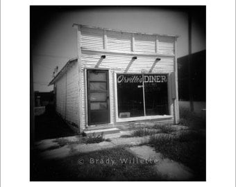 Orville's Diner holga photo of old Texas diner with wood siding in