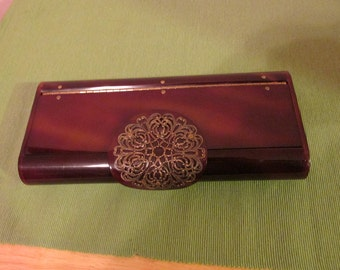 "Vintage ""WILARDY"" tortoise shell lucite clutch with bronze filigree catch"