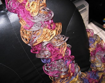 Ruffle scarf multicolor knit from special Ribbon yarn by pulling coloured in width and length can be changed