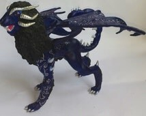 Blue manticores, winged lion, fantasy animal, a blue lion with wings, of velvety plastic and acrylic