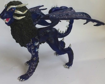 Blue manticore, winged lion, fantasy animal, a blue lion with wings, of velvety plastic and acrylic