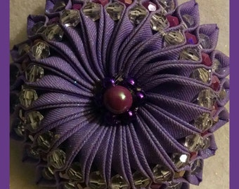 Purple bejeweled kanzashi hair bow