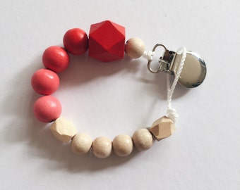 Hand-painted dummy in an ombre look with geometric wooden beads - Red