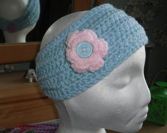 Childs pretty 2 tone blue earwarmer with pink decorative flower.