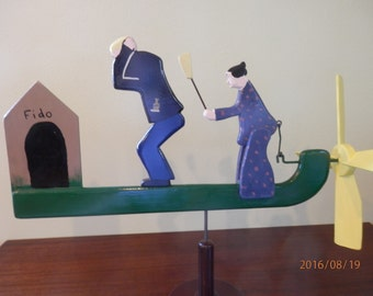 woman beating man with a broom whirligig, In the Dog House! whirligig, folk art. yard decoration, kinetic art, outdoor art