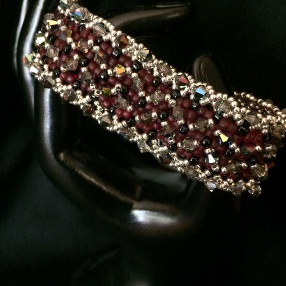 NO 63 Hand woven crystal and glass bracelet