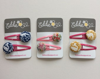 Eddie & Bee fabric covered button hair clips.