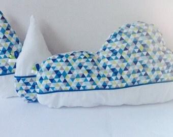 Pillow features nuge guttes
