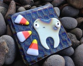 Rotten tooth and candy corn fused glass art tile